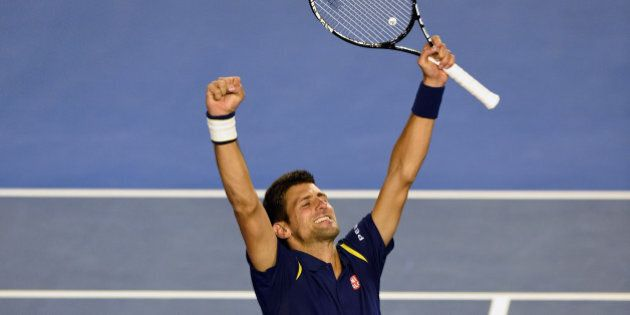 Novak Djokovic of Serbia celebrates his victory over Andy Murray of Britain in their men's singles final...