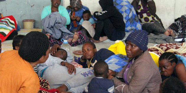 Illegal African migrants sit in a shelter following their arrival by boat at the Zawiyah port, a Libyan naval base some 45 kilometres west of the capital Tripoli, after they were rescued off the western city of Sabratha on May 24, 2016 as they were trying to reach Europe by boat. Workers on a Libyan oil tanker helped to rescue 135 people from boats in the Mediterranean, an AFP journalist said, hours after coastguards detained 550 would-be migrants headed for Europe. Libyan coastguards earlier today that they had detained 550 people trying to reach Europe illegally by boat / AFP / MAHMUD TURKIA        (Photo credit should read MAHMUD TURKIA/AFP/Getty Images)