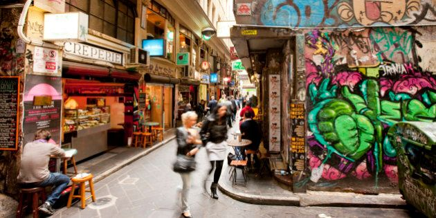Busy city laneways, with cafes and graffitti, Melbourne, Victoria,