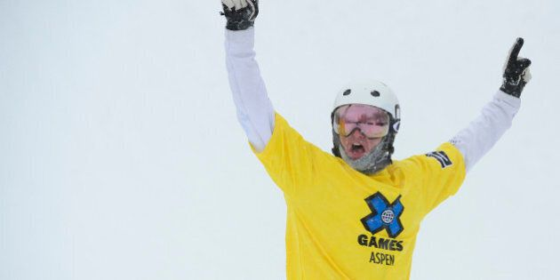 ASPEN, CO - JANUARY 31: Jarryd Hughes raises his arms in victory after winning the men's ski cross finals...
