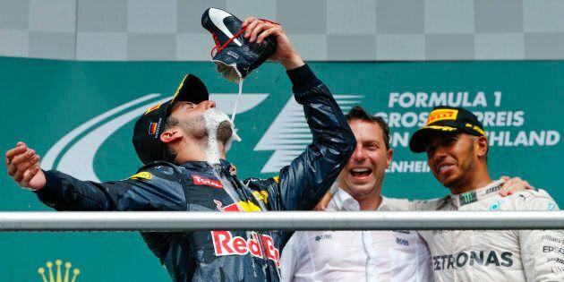 Lewis Hamilton watches Ricciardo down the