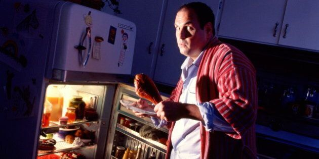 Man looking shocked, taking food out of refrigerator at