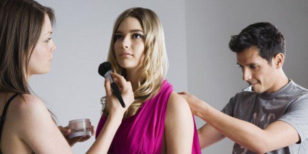 Designer and Makeup Artist Preparing Model for Photo Shoot