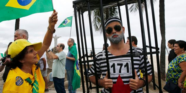 Protesters take part in a demonstration to demand the impeachment of suspended President Dilma Rousseff...