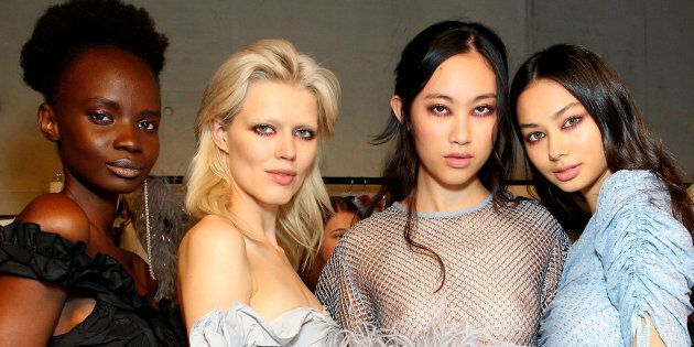 Models backstage ahead of the Alice McCall show at Mercedes-Benz Fashion Week Resort 18 Collections at