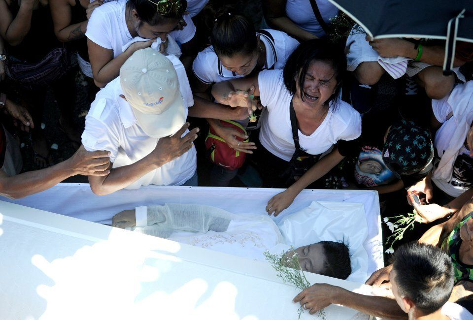 Jennilyn Olayres cries at the coffin of her partner Michael Siaron who was killed by suspected vigilantes...