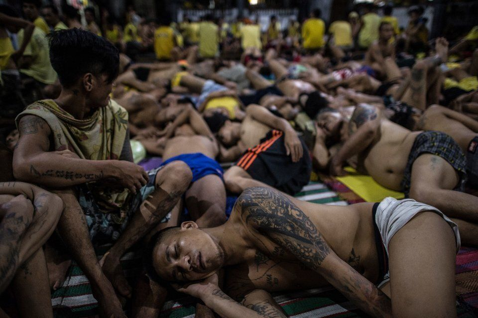 Inmates sleep on the ground at Quezon City jail because it was built to house 800, but there are currently...
