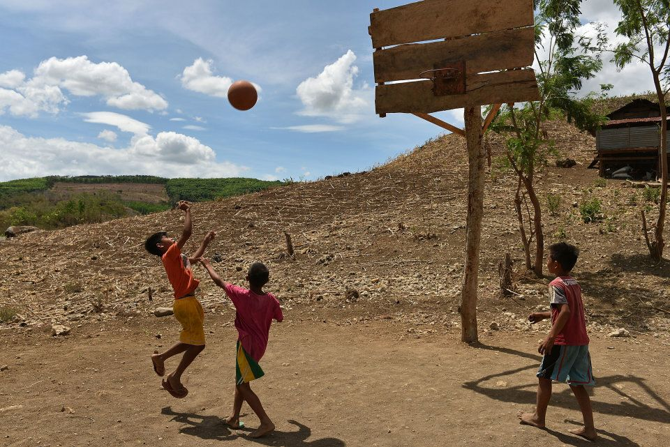 Children play basketball in Mindanao, the