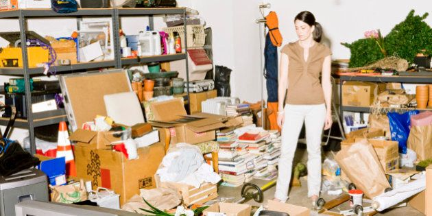 Frustrated woman looking at clutter in