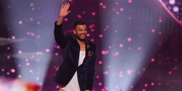 VIENNA, AUSTRIA - MAY 23: Guy Sebastian of Australia arrives on stage during the final of the Eurovision...