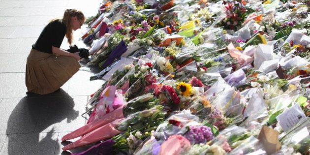 SYDNEY, AUSTRALIA - DECEMBER 17: Flowers are left as a sign of respect at Martin Place on December 17,...