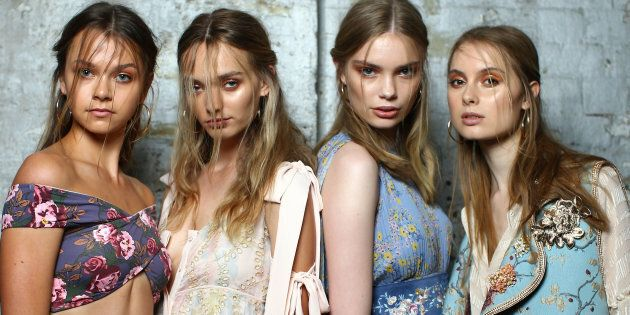 Models pose backstage ahead of the We Are Kindred show at Mercedes-Benz Fashion Week Resort 18 Collections at Carriageworks.