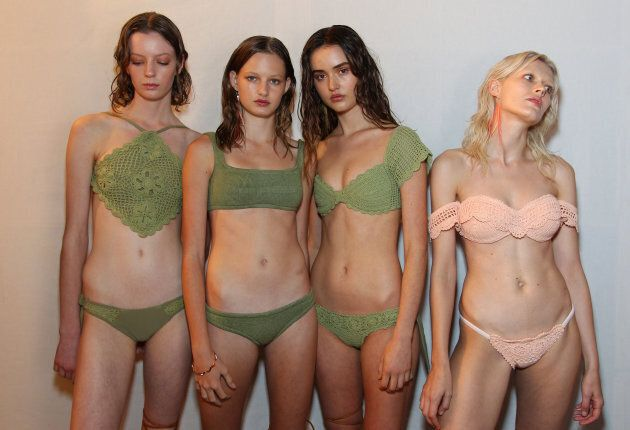 Models pose backstage ahead of the Swim show.