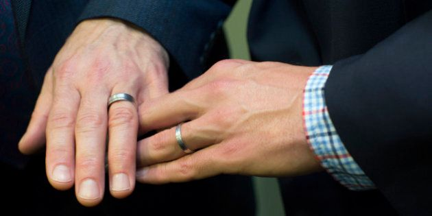 Men's hands together showing wedding