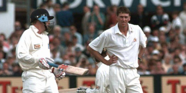 Australia's Glenn McGrath watches as England's Captain Michael Atherton, left, adds runs to England's...