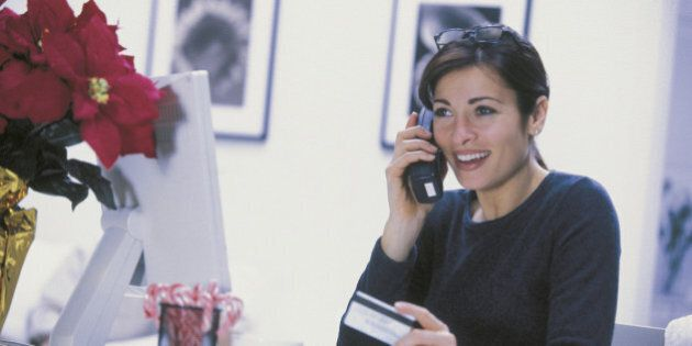 Woman ordering by phone at Christmas
