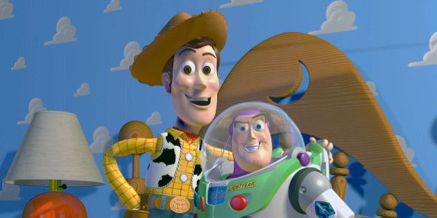 This film publicity image released by Disney Pixar shows characters Woody, left, and Buzz Lightyear,...