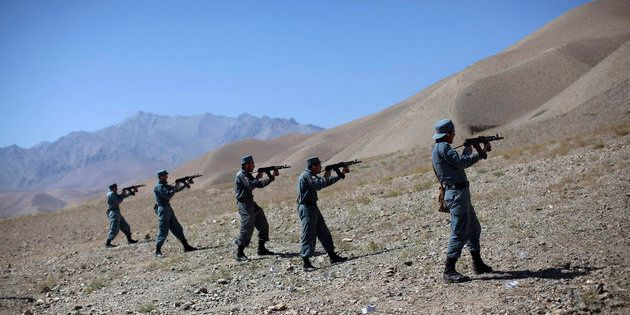 Afghan policemen train at a live firing range in the central province of Bamiyan August 22, 2011. REUTERS/Ahmad...