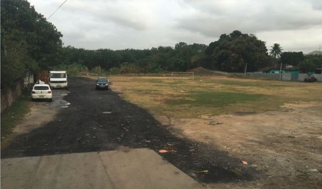 This soccer field in a slum area of Rio will be driven past every day by athletes going to shiny new