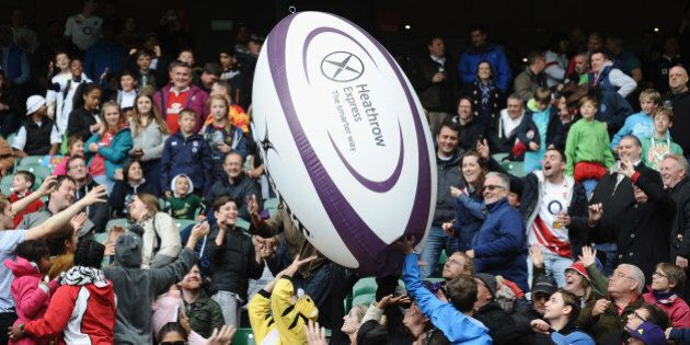 LONDON, ENGLAND - MAY 11: The crowd play with a giant rugby ball in the stands during The Marriott London...