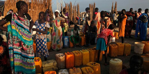 Women displaced by the fighting wait to get clean water at a water point in a camp for internally displaced...