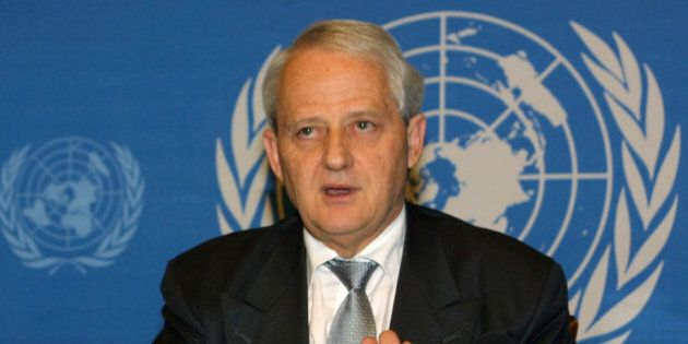 Australian Immigration Minister Philip Ruddock briefs the press at Geneva, Switzerland, on Wednesday,...