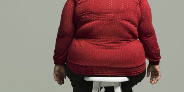 Obese woman on chair, rear