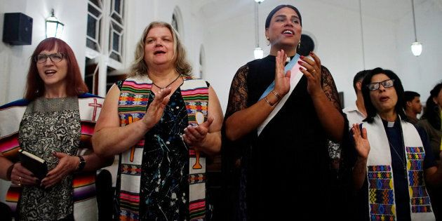 Trans Baptist reverend Allyson Robinson from the U.S. (L), trans pastors Cindy Bourgeois from Canada (2nd L) and Alexya Salvador from Brazil (2nd R) and lesbian pastor Elaine Saralegui sing during a mass in Matanzas, Cuba, May 5, 2017. Picture taken on May 5, 2017. REUTERS/Alexandre Meneghini