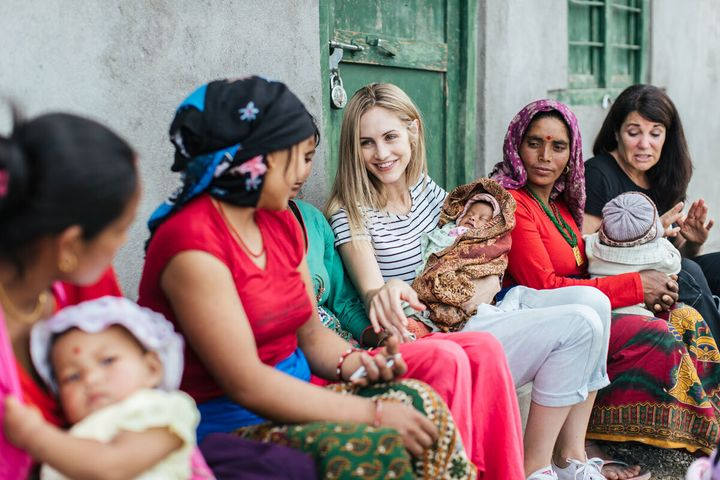 Justine Flynn chats to local mothers in Nepal.