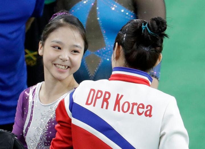 South Korea's Lee Eun-ju talks with North Korea's Hong Un Jong.