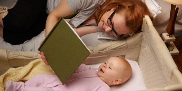Mom reading baby bedtime