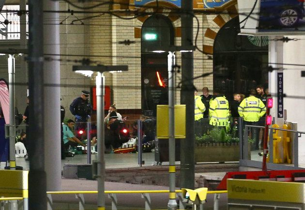Injured concert-goers are treated by emergency services at Victoria Railway Station close to the Manchester...