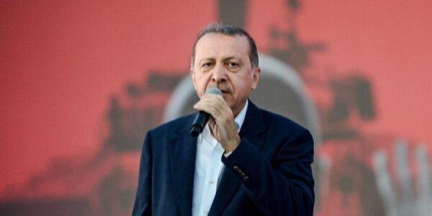Turkish President Recep Tayyip Erdogan speaks on August 7, 2016 in Istanbul during a rally against the failed military coup on July 15.