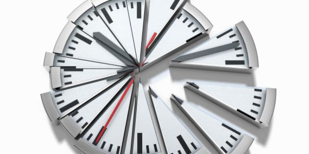 A clock is split into several pieces, in front of white background, cutout, digital composite.