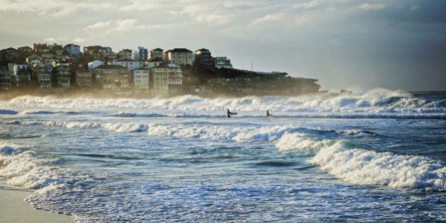 Bondi Beach, Sydney, Australia, on a fine winter morning with good surf, two surfers just walking out...