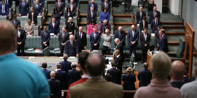 The Parliament of Australia stands to observe the victims of the Manchester terrorist attack during question...