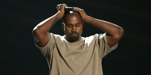 Kanye West reacts as he accepts the video vanguard award at the MTV Video Music Awards at the Microsoft...