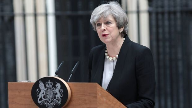 British Prime Minister Theresa May updates the