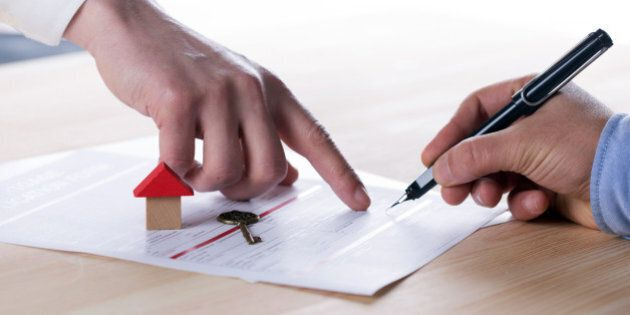 New homeowner signing contract of house sale or mortgage