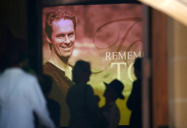 An image of Sydney cafe siege victim, cafe manager Tori Johnson is projected on a giant screen at his...