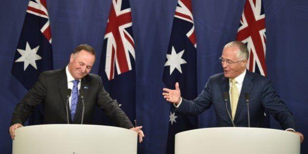Australia's Prime Minister Malcolm Turnbull (R) and New Zealand Prime Minister John Key (L) hold a joint...