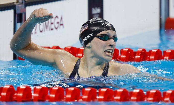 U.S. swimmer Katie Ledecky wins gold and sets a new world record in the Women's 400m Freestyle.