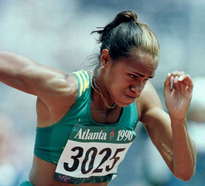 Cathy Freeman feels the burn in the Women's 400 metres qualifying round at the Atlanta Olympics.