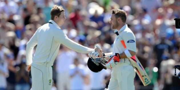 New Zealand's captain Brendon McCullum, right, shakes hands with Australia's captain Steve Smith...