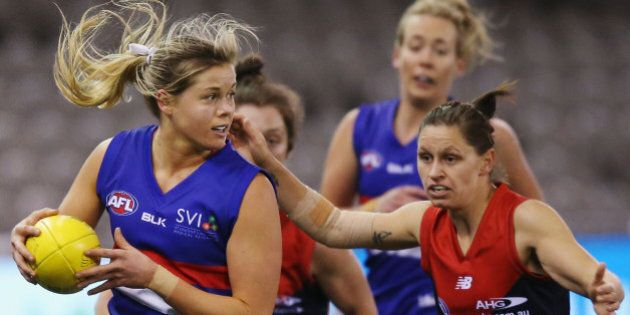 MELBOURNE, AUSTRALIA - AUGUST 16: Katie Brennan of the Bulldogs looks upfield during a Women's AFL exhibition...