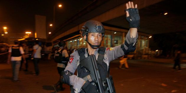 Police guard at a scene of an explosion in Jakarta on Wednesday