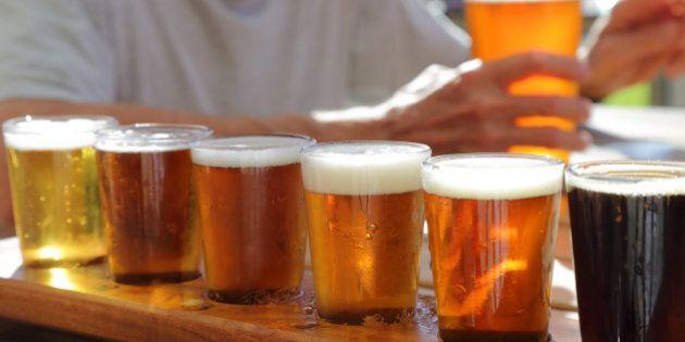 lots of pints of beers , man in