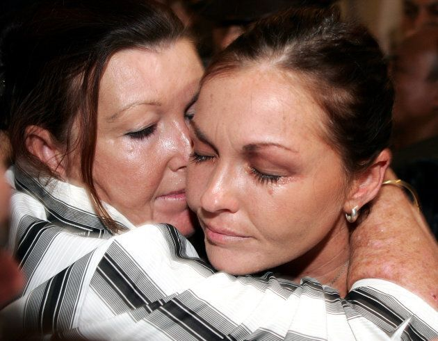 Schapelle Corby is hugged by her mother, Rosalie Rose, after she was found guilty of drug