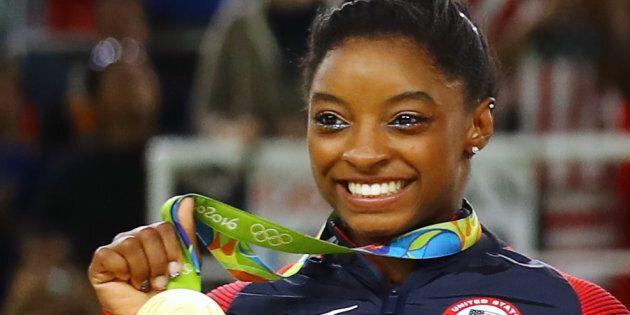 Gold medal, golden smile.