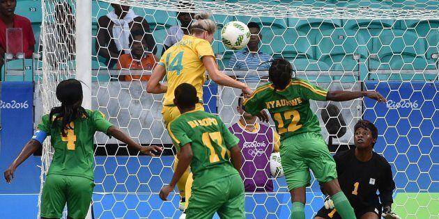 Alanna Kennedy heads to score against Zimbabwe.